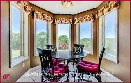 Your own picturesque breakfast room awaits you in this amazing Haddam CT waterfront home for sale.