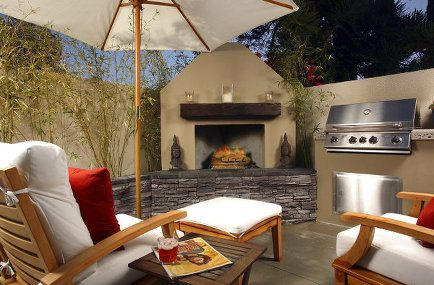 An outdoor space complete with seating and bbq.