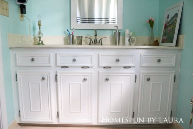 The $200 Master Bathroom Refresh | Homespun by Laura | Painted vanity and spray painted knobs brighten the space for free