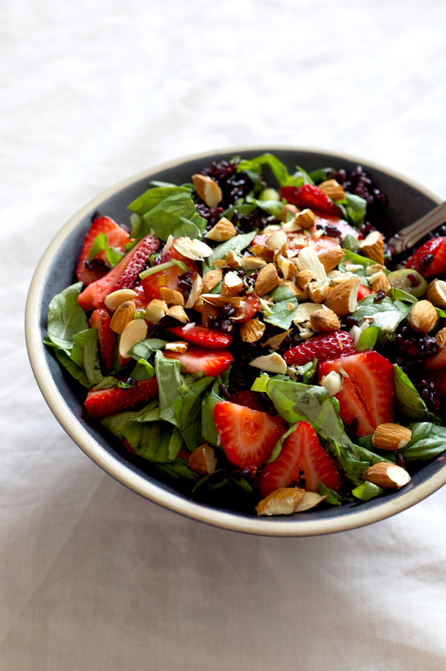 Strawberry and Basil Black Rice Salad with a ginger lemon dressing. Vegan and gluten free. A simple and festive early summer salad. Recipe at Homespun Capers.