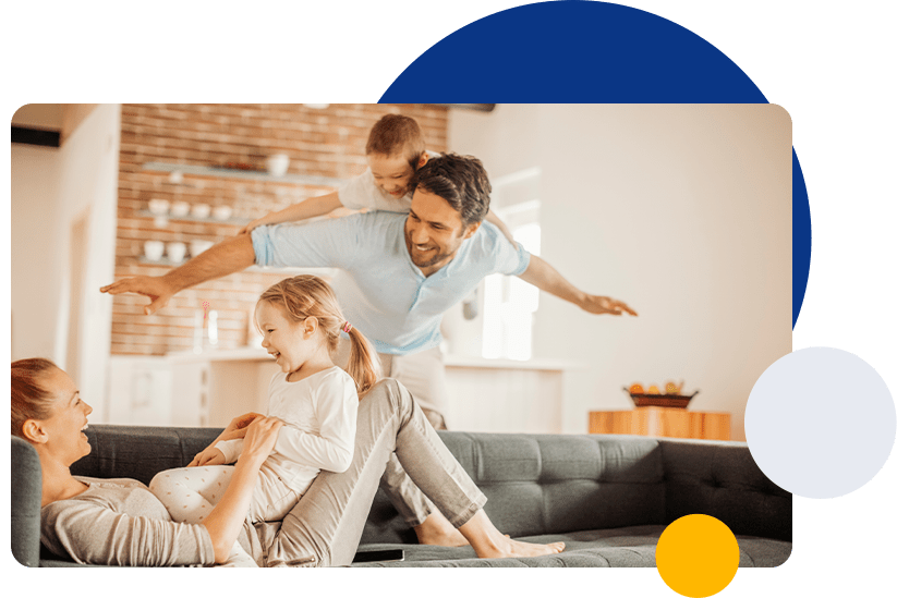 Happy family playing inside house
