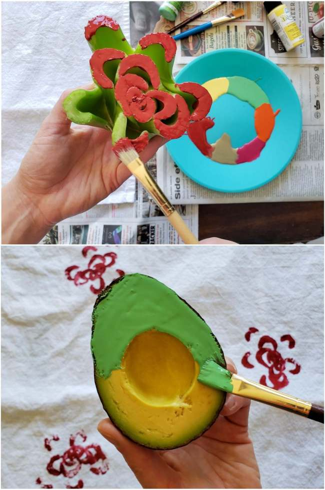 A two part image collage, the first image shows a hand holding the celery heart with one hand while the other hand, holding a paint brush, is brushing red paint onto the ends of each celery stalk. Once used as a stamp, the cut celery heart resembles a flower. Underneath lies the blue plastic plate used as an easel sitting atop newspaper along with various paints and paint brushes. The second image shows a hand holding the half of an avocado while the other hand is brushing green paint on the face of the avocado, once the side of the fruit is completely covered, it will be used to stamp the tea towel.