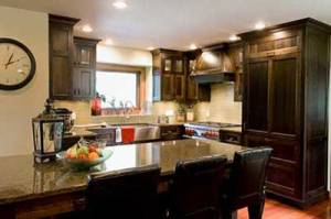 kitchen with grey granite countertops and dark maple wood kitchen cabinets interior kitchen renovations red deer