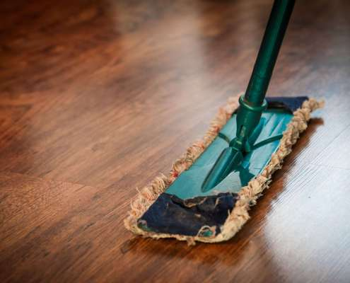 person using mop for spring cleaning