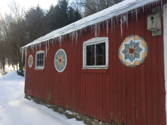 Icicles hang from the Handyman's workshop