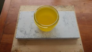 beeswax polish on wood table before cooling