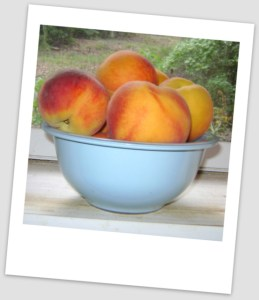 peaches in blue bowl