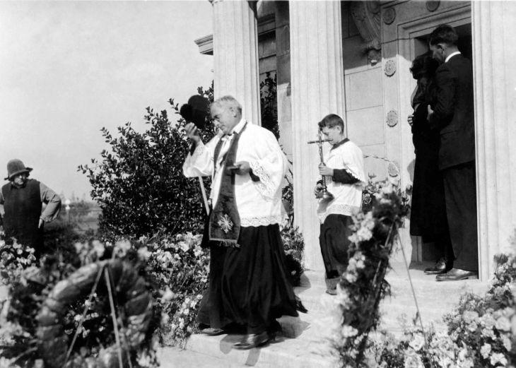 John H Temple Funeral Priest Exits Mausoleum 2002.89.48.12