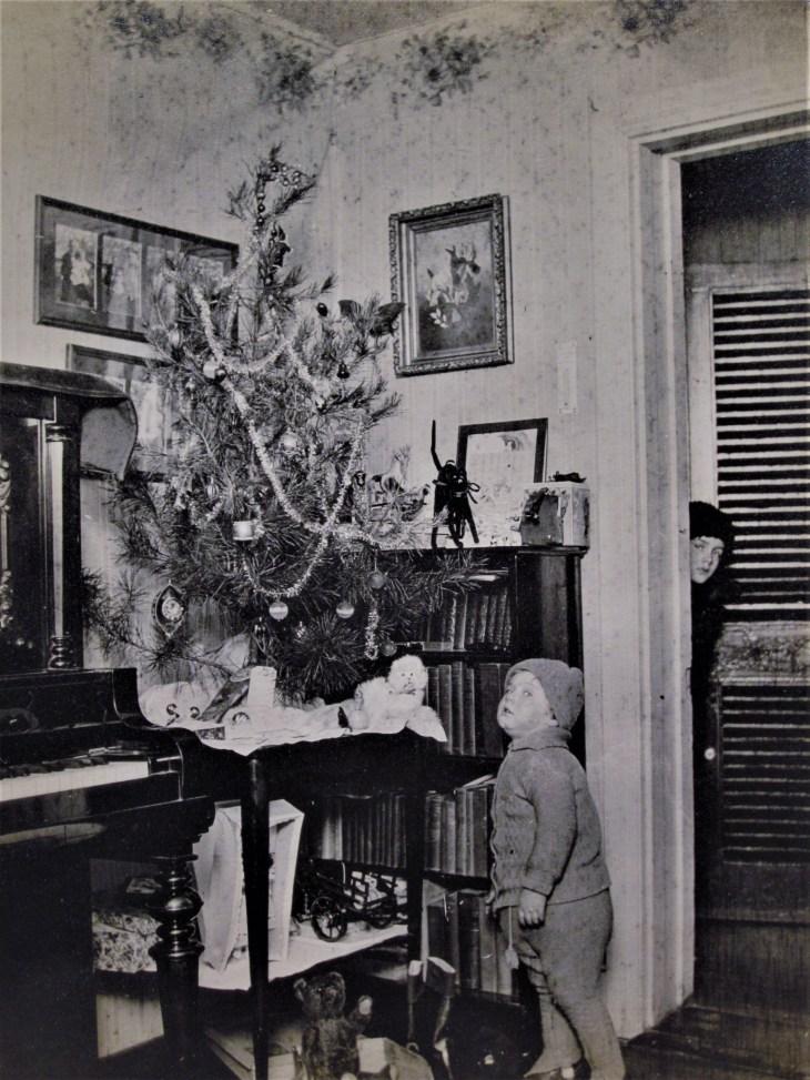 2 boys nr Xmas tree 1900s