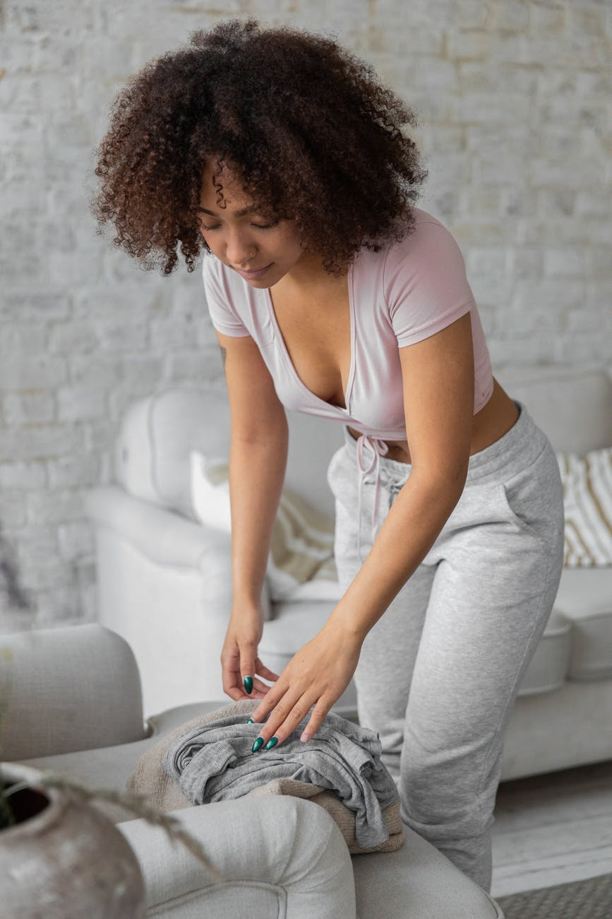 black woman doing housework in stylish apartment