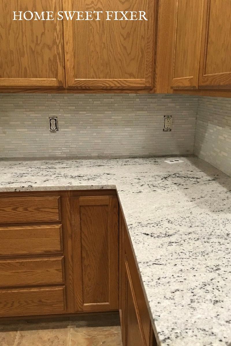 white granite counter tops glass tile