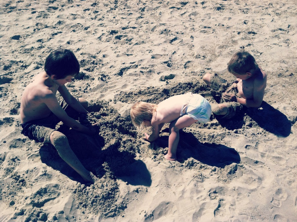 children learning on the beach