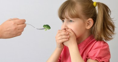 girl covers mouth to block broccoli - picky eaters