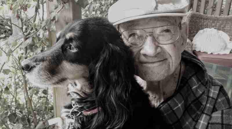 older man and dog