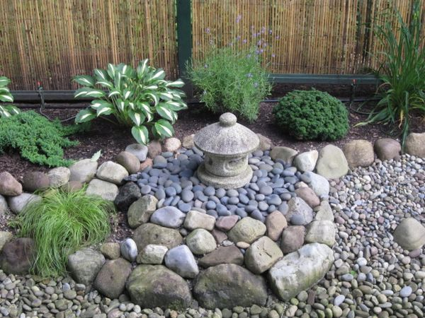use a rock garden to create a unique  lovely look for your backyard
