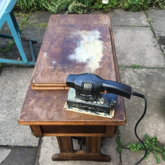 Singer sewing machine treadle table before sanding