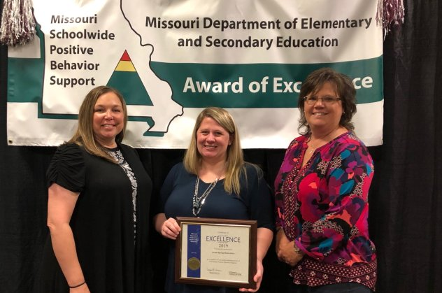 : (L to R) Rhonda Davis, Laura Weber, and Tonya Baker receive the PBIS Award for Reeds Spring Elementary School.