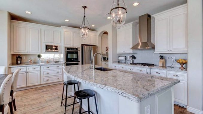 Kitchen With Moon White Granite Counters And White Cabinets.jpg