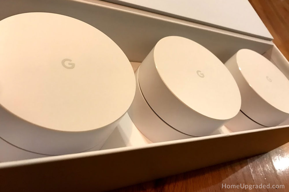 Open Google WiFi box with 3 WiFi points inside.
