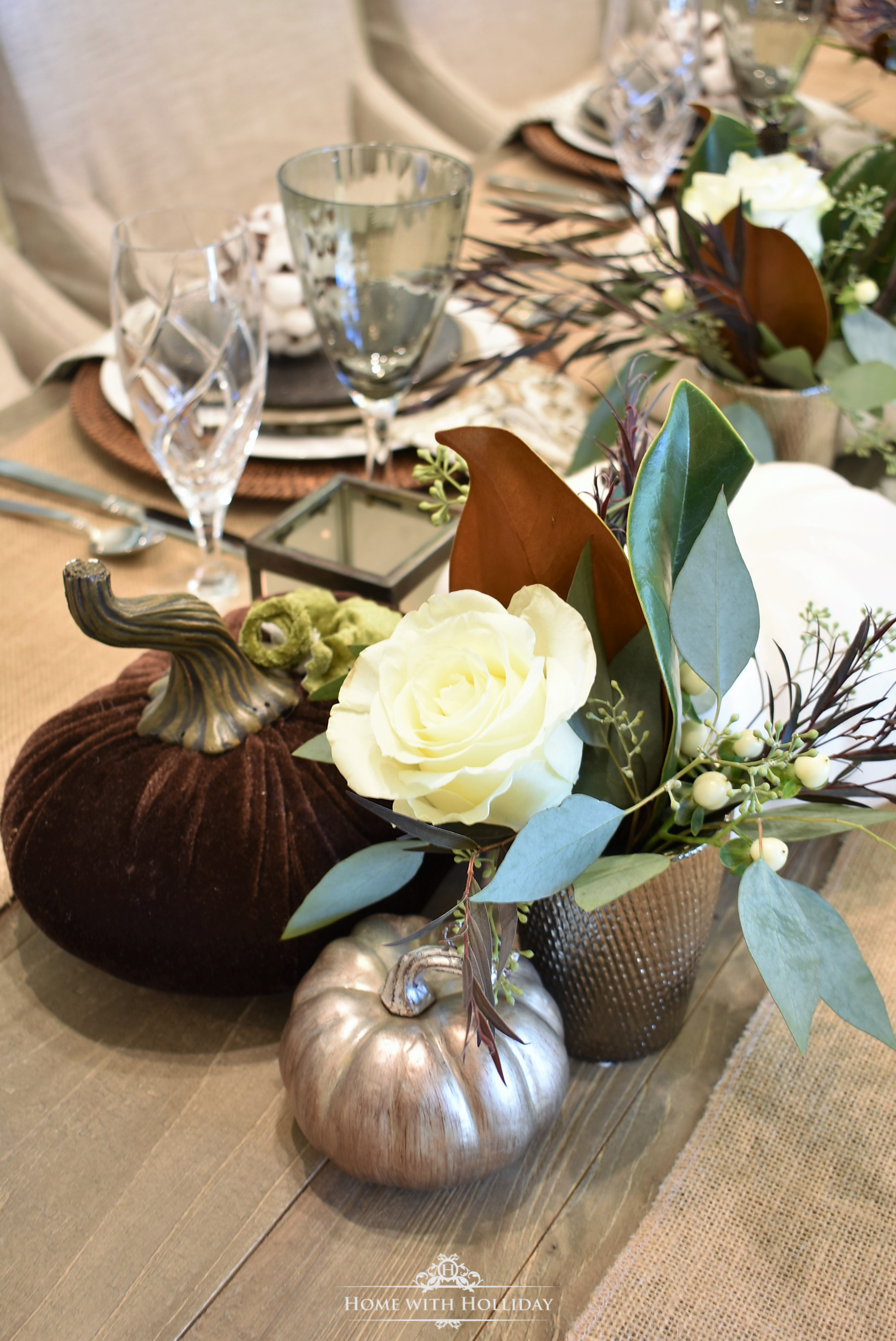 Details of a Fall Table Setting with Brown and White Pumpkins