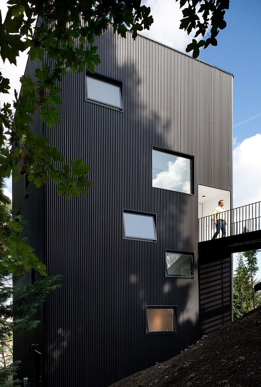 Modern Vertical House Accessed By A Steel Pedestrian Bridge