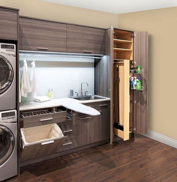 Laundry room storage with foldable ironing table 4 (source pinterest.com)