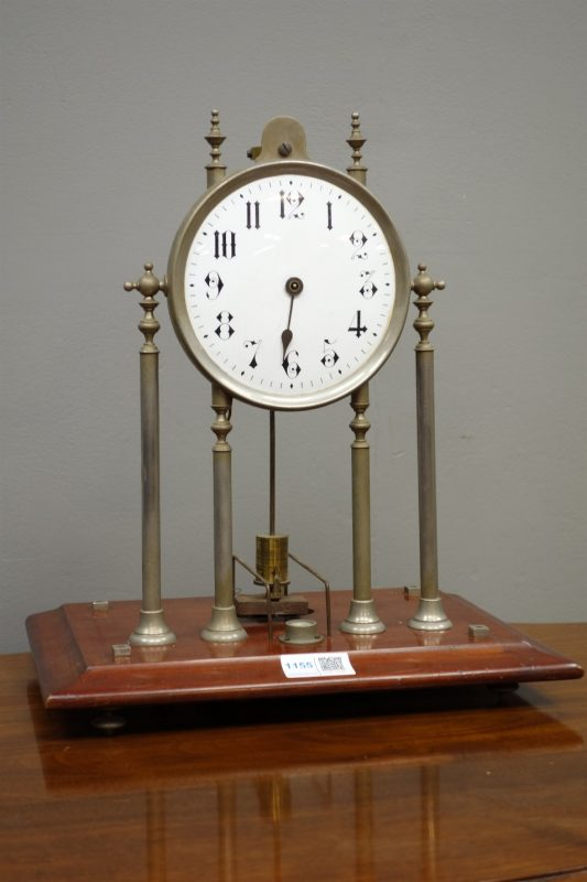 Scott's Electric Clock', early 20th century electric magnetic mantel clock,  circular Roman dial on chrome column supports, No.1210, on mahogany plinth:  Patent No10,271 c1902, marketed by Ever Ready - Jewellery, Silver, Clocks