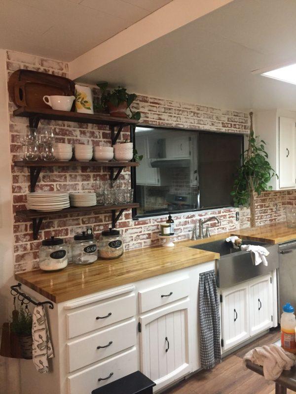 Farmhouse kitchen with faux brick backsplash | Rustic kitchen, Faux brick  backsplash, Kitchen cabinets decor