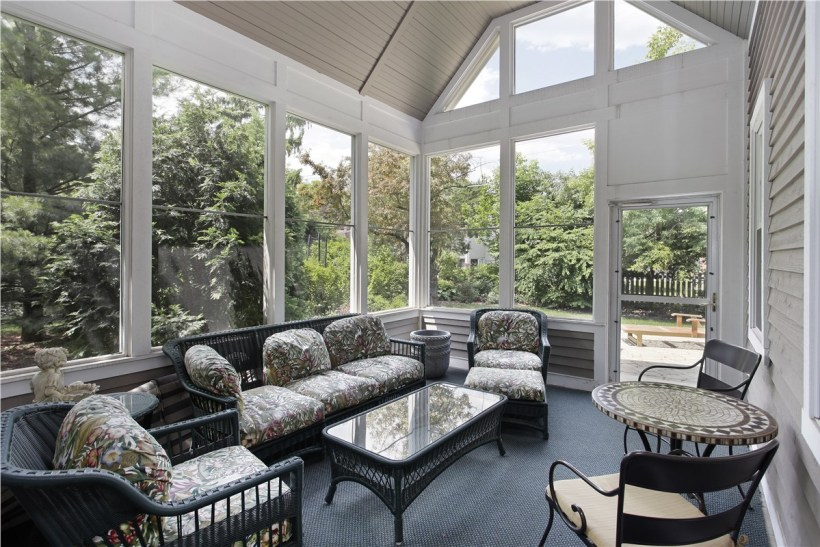 Modern Screened Patio with Floral Touch