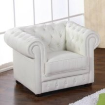 3. Fauteuil cuir Chesterfield.