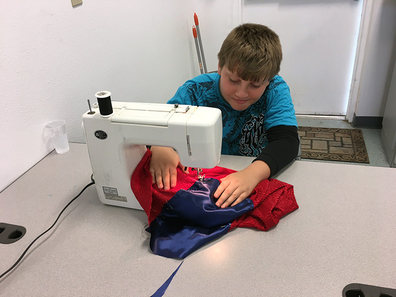 Jed sewing for Fashion Fantasy show