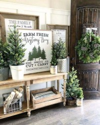 Welcoming Christmas Entryway Decoration For Your Home 31