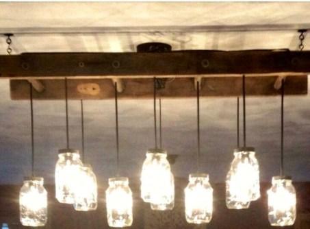 Magnificient Farmhouse Ladder Chandelier Ideas 14