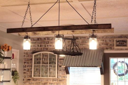 Magnificient Farmhouse Ladder Chandelier Ideas 28