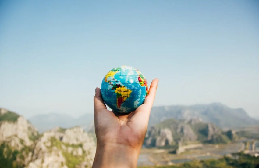 small globe held in a hand