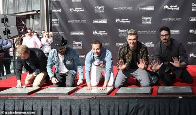 12219040-6918167-Forever_remembered_The_men_knelt_on_the_red_carpet_stage_showing-a-14_1555126657833