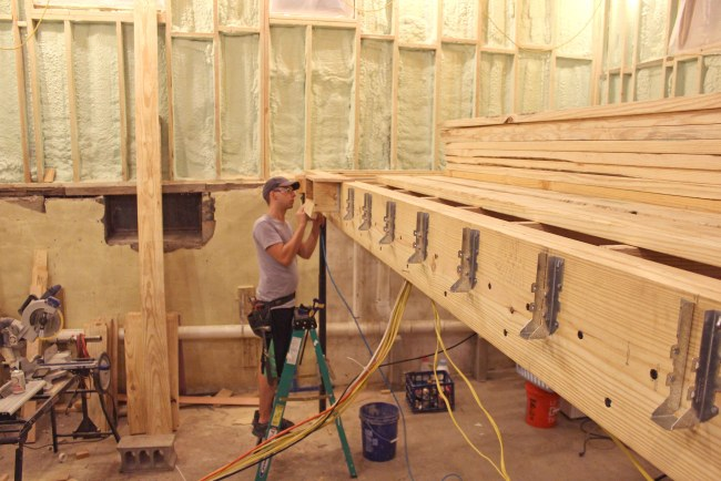 Brandon installing the joist hangers