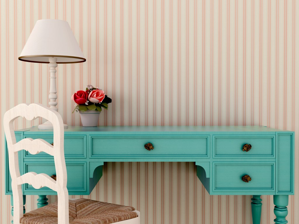 Rustic teal blue desk against striped wallpaper.  Pretty lamp and flowers on desk.