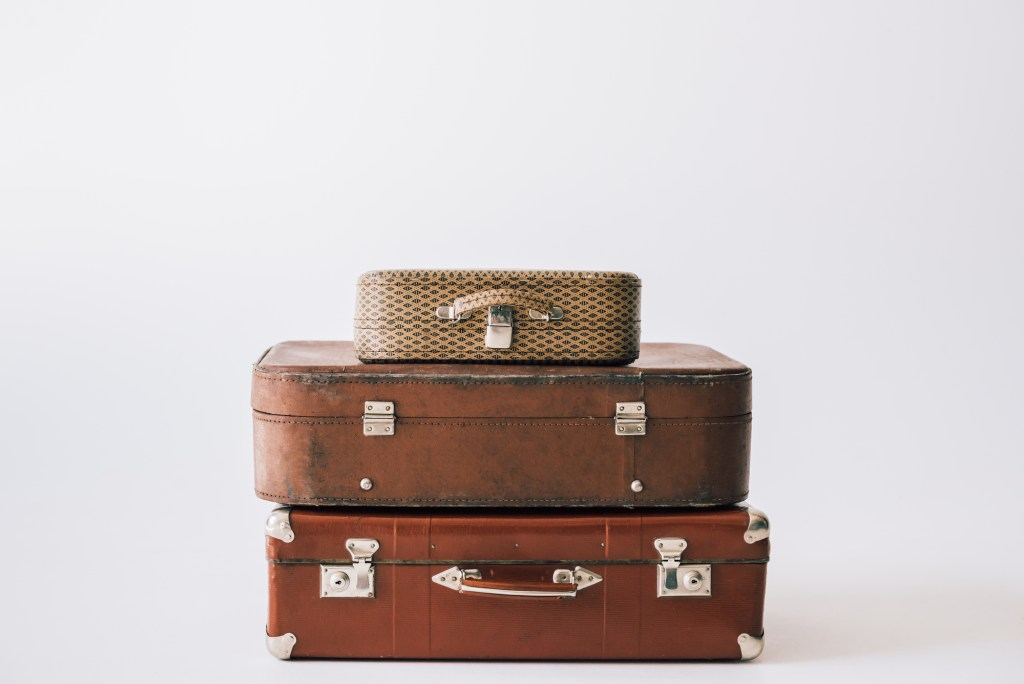 stack of vintage suitcases ready to be unpacked after vacation