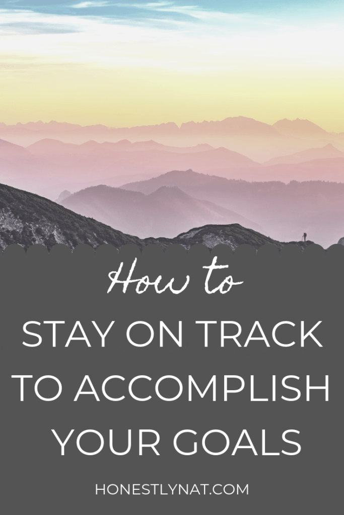 "Colorful mountain sunset with the text overlay ""How to stay on track to accomplish your goals"""