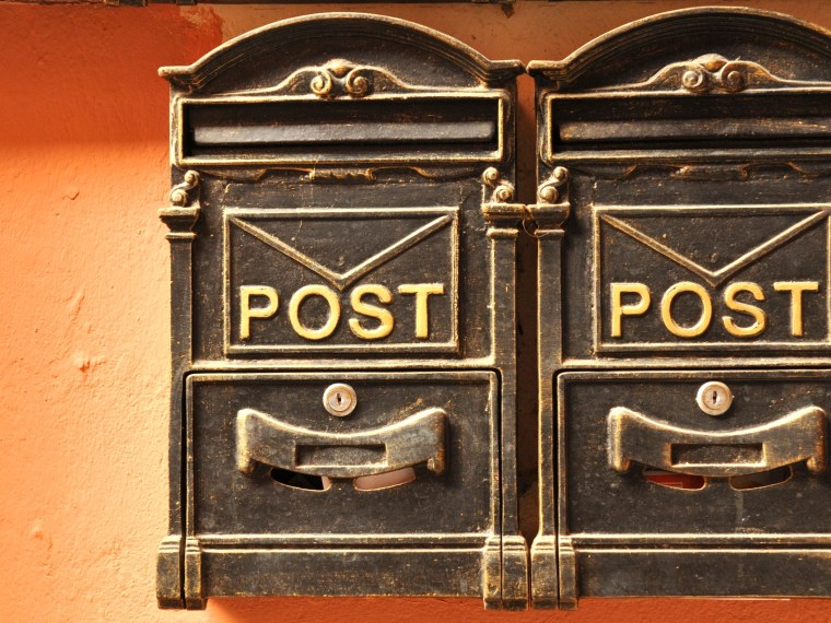 Rustic post boxes in a row