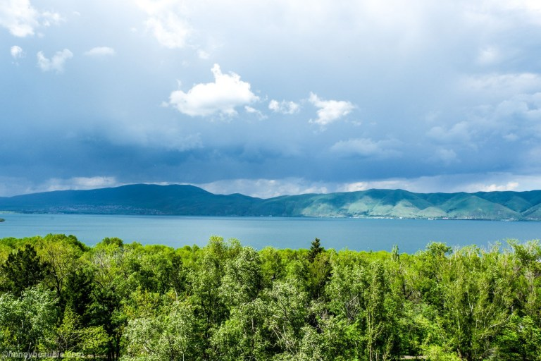 View of Sevan Lake from the other side where dark clouds are looming.