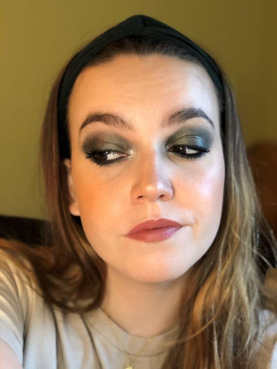Emily wearing a deep, dark green smoky eyeshadow look