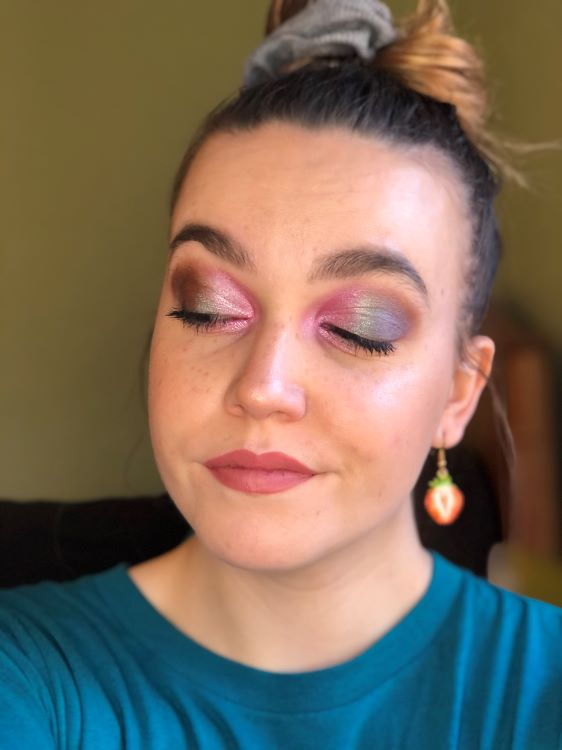 Emily showing off her shimmery pink and brownish eyeshadow look