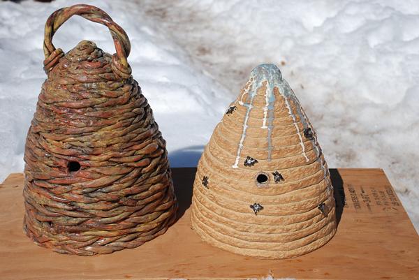 Bees in art: minature skep hives by Michael Skeels of Montana.