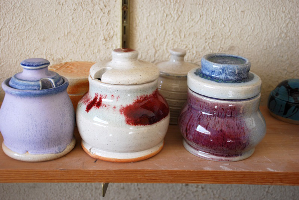 A useful and beautiful wintertime beekeeping project: ceramic honey pots. Pots and photo © Michael Skeels.