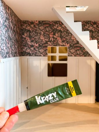 Krazy Glue used to create DIY board & batten in the doll house makeover