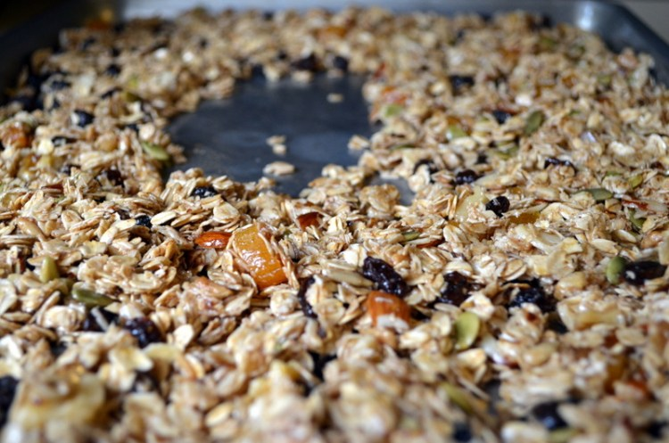 Granola Spread Out in Baking Sheet