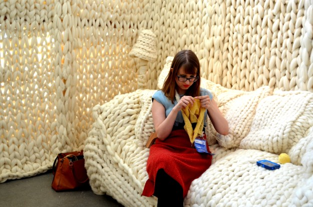 An artist knitting away in her Art Prize Yarn House exhibit...very original and cozy to boot.