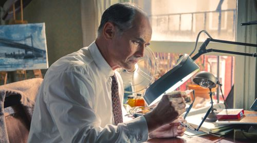 Bridge of Spies' Mark Rylance looks closely at tiny secret document